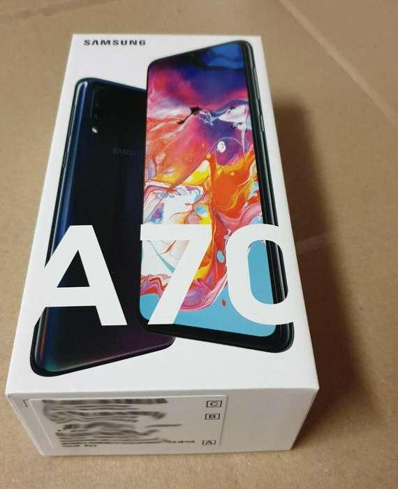 Telefono SAMSUNG A70 negro con TODO nuevo y audifonos