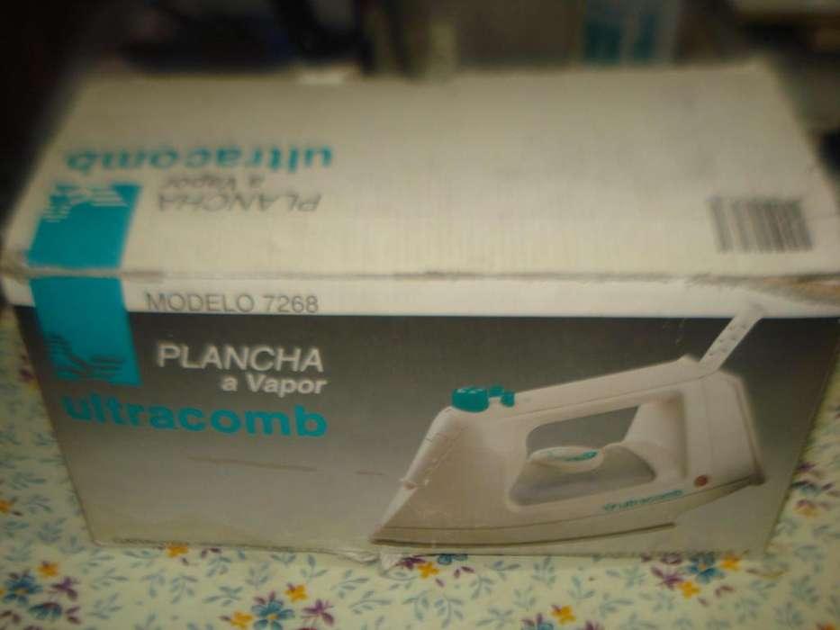 <strong>plancha</strong> A Vapor Ultracomb 7268 Usada Funcionando