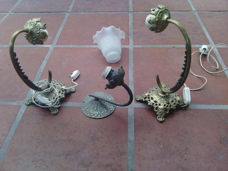 Veladores y aplique de bronce