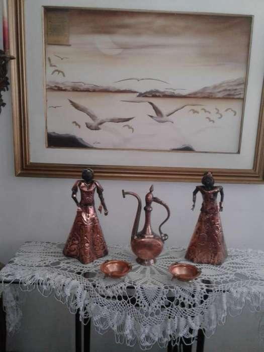 muñeca en cobre