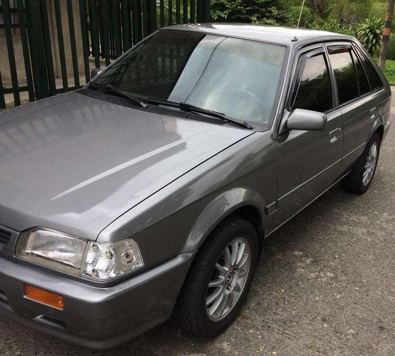 Mazda 323 2002 - 100000 km