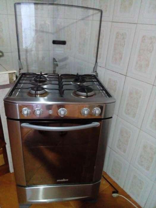 Estufa con horno mabe gris cuatro hornillas