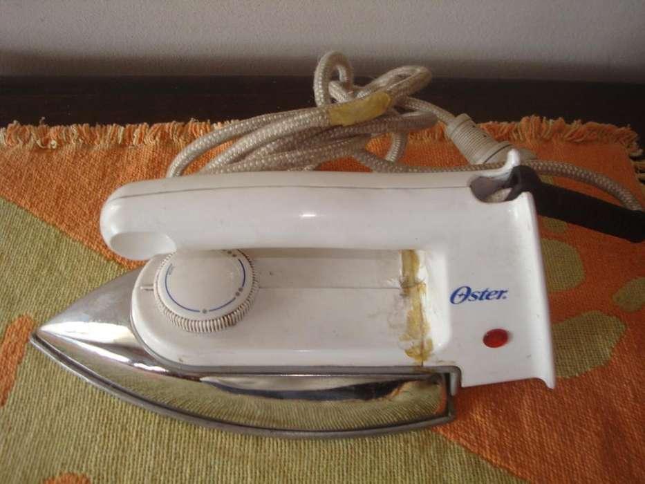 Plancha Oster Usada Mango Roto Funcionando Modelo 402854