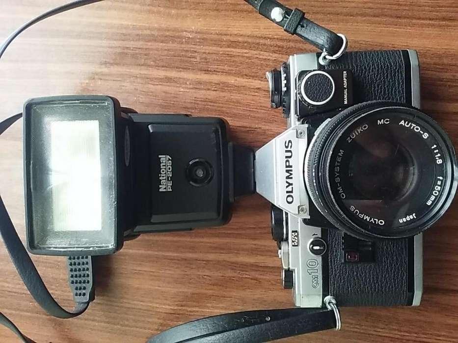 Camara Reflex Olympus Om10, flash National, accesorios Funcionando