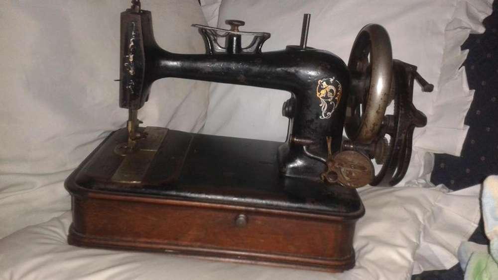 antigüedad maquina de coser singer