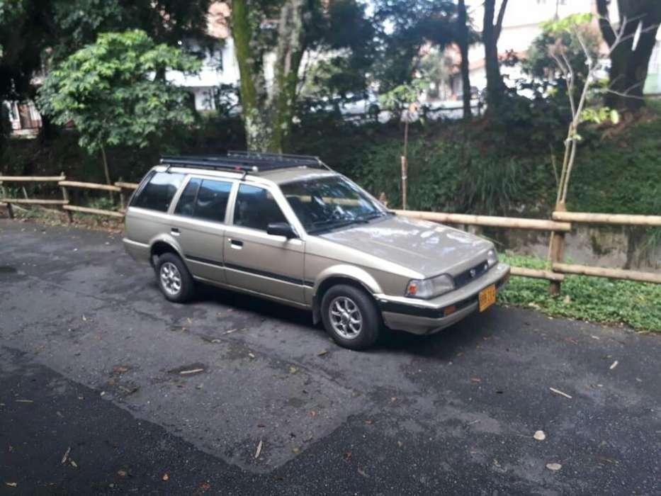 Mazda 323 1991 - 296358 km