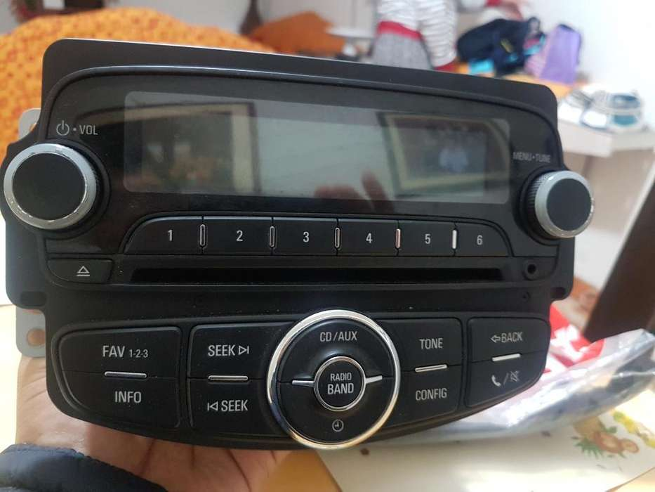 Consola Y Radio Chevrolet Sonic Aveo