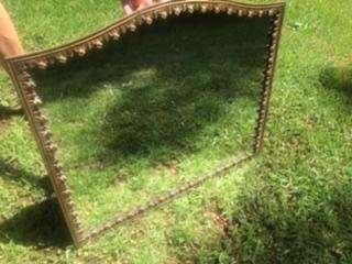 Espejo con marco de bronce labrado