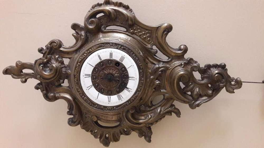 Reloj <strong>cartel</strong> de bronce