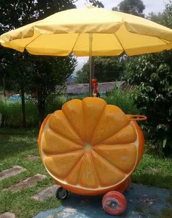 Vendo hermoso carro de jugos en forma de naranja, diseño llamativo al cliente.