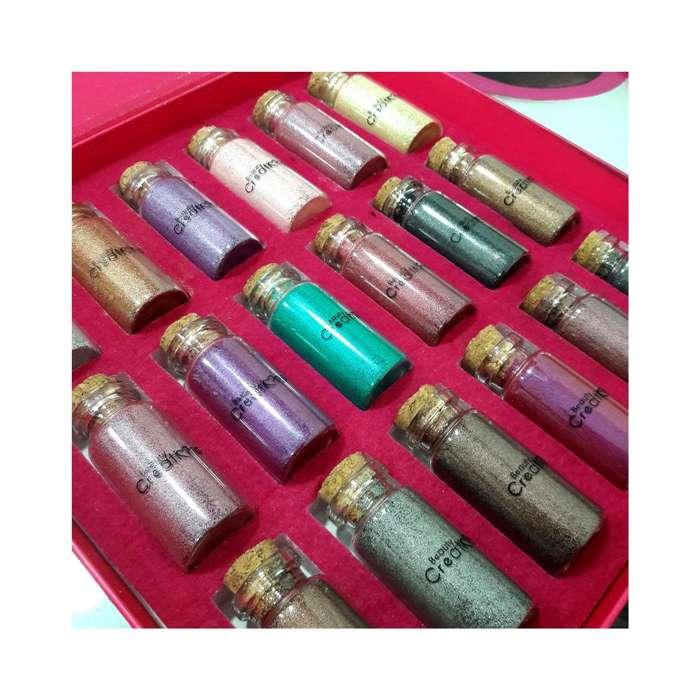 caja de glitters beauty creationss 18 tonos