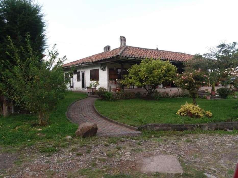 Venta de Casa tipo Hacienda mas 3000mt de terreno a 15 Minutos de Cuenca