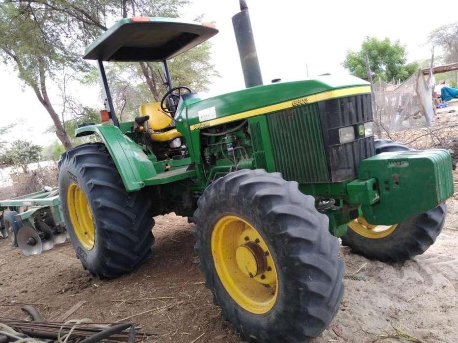 Tractor John Deere en excelentes condiciones, con rastra en Piura