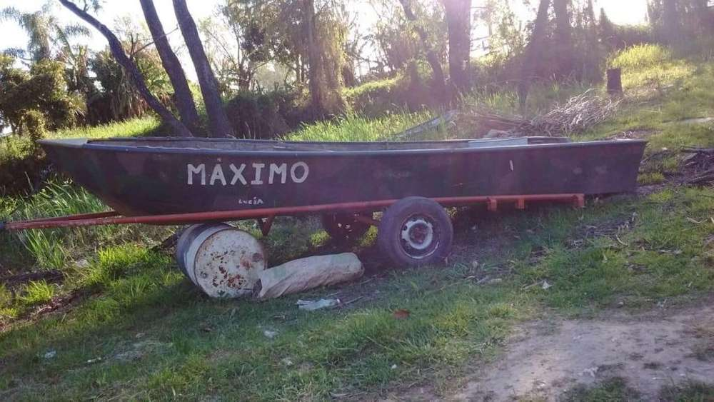 Vendo lancha con motor estacionario de 16 hp y triler includo