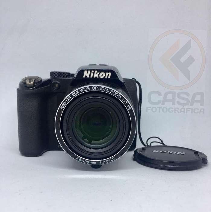 COMO NUEVA!! Nikon P100 cargador Memoria16Gb Correa Tapa lente