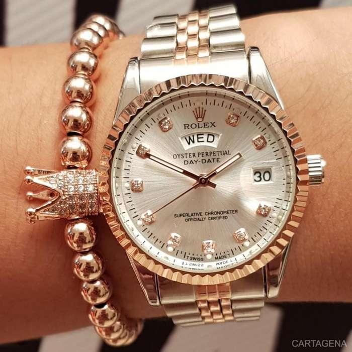 Reloj Rolex rosado con plateado para dama en venta