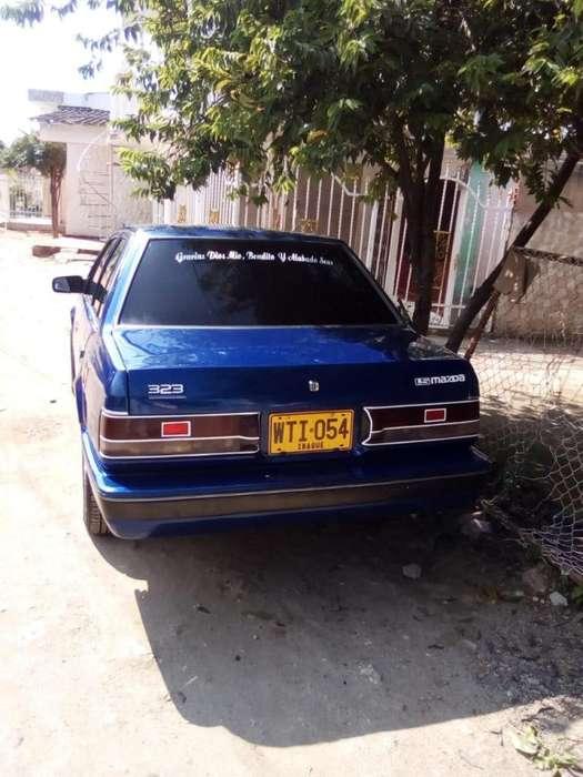 Mazda 323 1998 - 23000 km