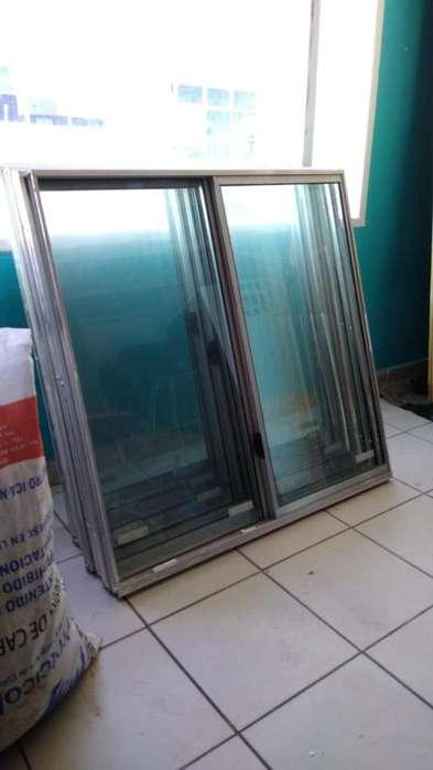 Ventanas en aluminio y vidrio en muy buen estado de una hoja corrediza