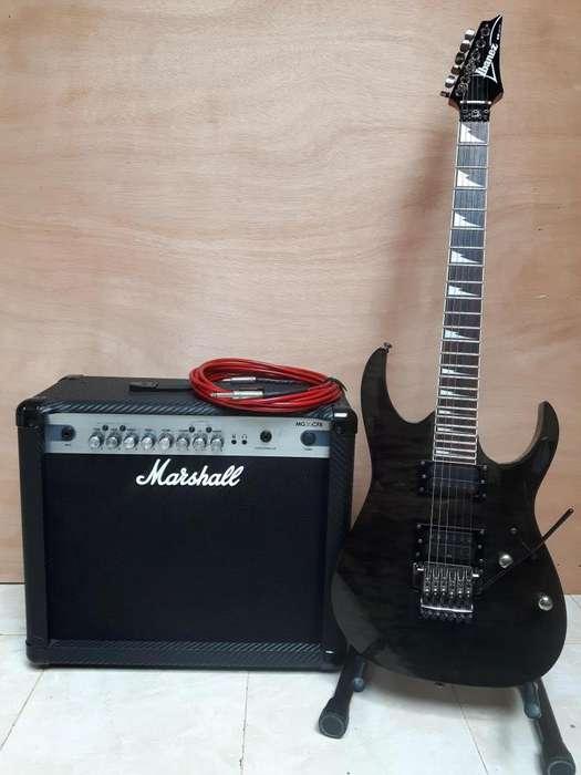Guitarra electrica Ibanez RG amplificador Marshall y cable fender