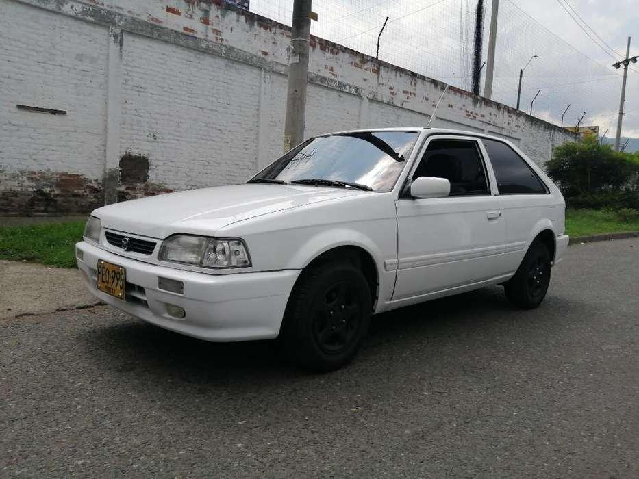 Mazda 323 2002 - 12000 km