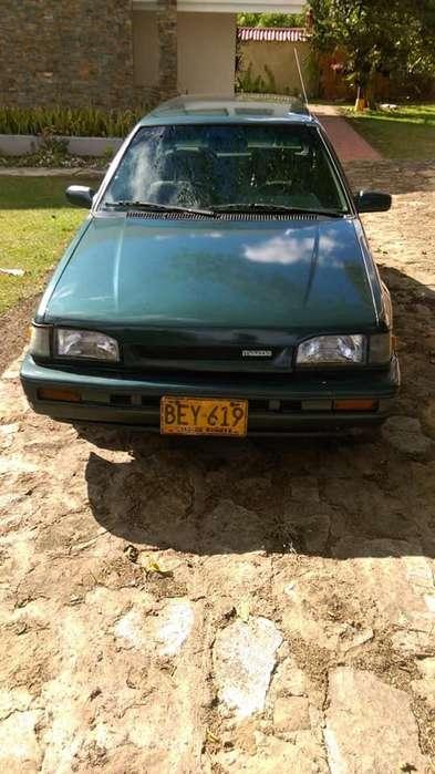 Mazda 323 1995 - 100 km