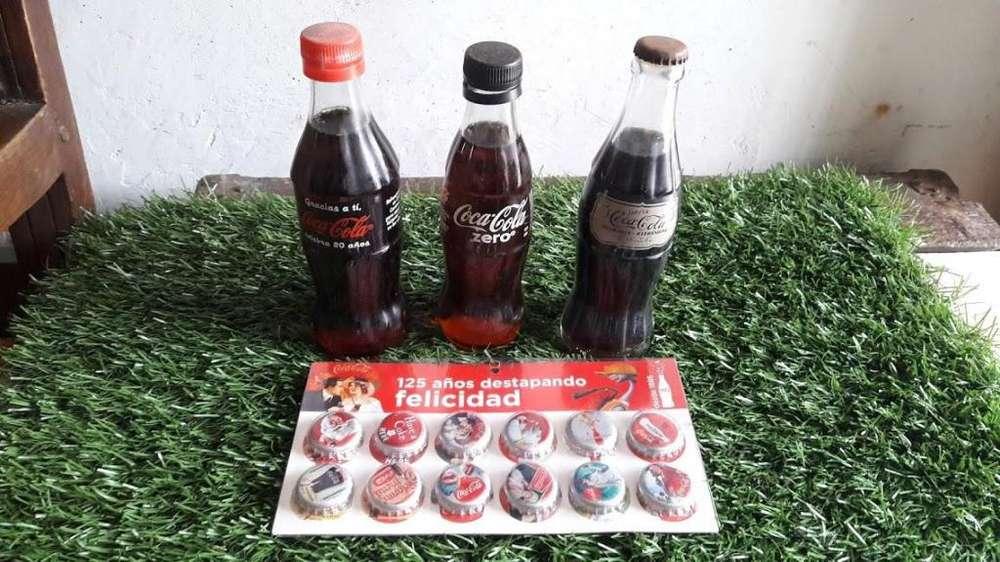 botellas y coleccinador de tapas 125 años Coca cola