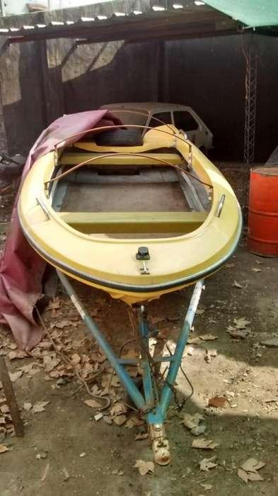 Bote pescador con trailer 153553306