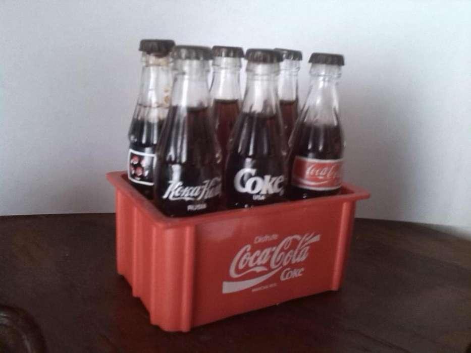 canastica de coca cola sin repetir nombres de los 6 paises