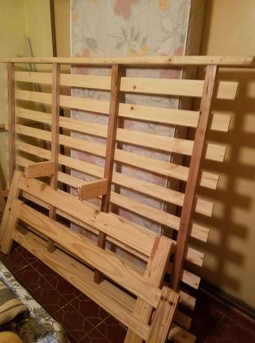 vendo cama de dos plazas sin colchon,de pino nueva 3500