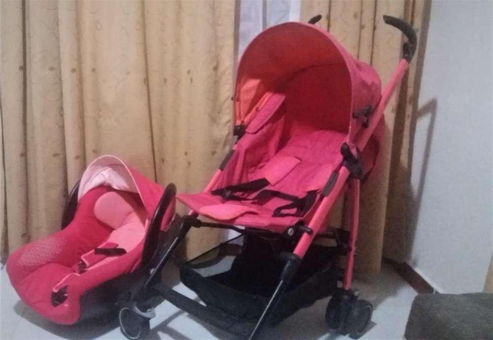 Coche Bebe Confort Mila. Incluye silla y soporte para el carro.