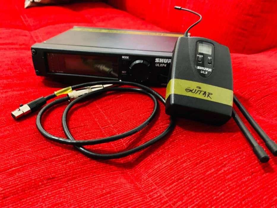 Sistema inalmbrico Shure ULXP4 para guitarra o bajo