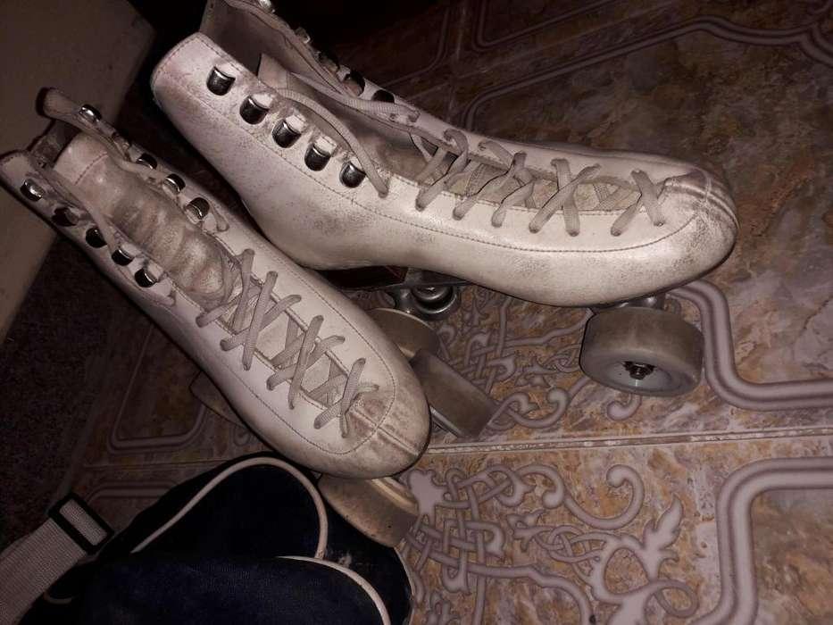 Vendo patines de escuela n38 con bolso y un excelente estado