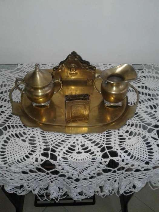 bandeja de cuatro piezas en bronce amarillo