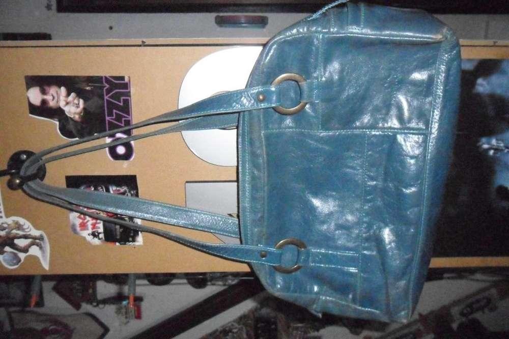 cartera de cuero turquesa, vendo o permuto por mochila