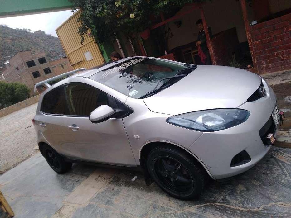 Mazda Demio 2009 - 14000 km