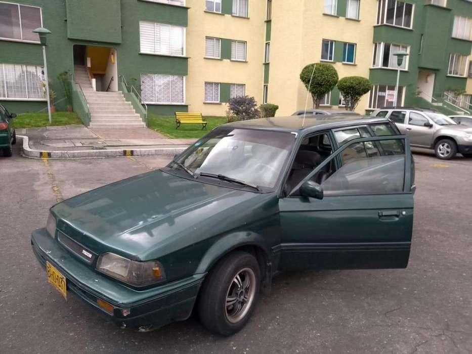 Mazda 323 1996 - 2000000 km