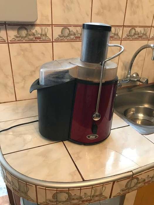 Extractor de jugos y microondas