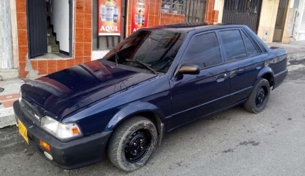 Mazda 323 1988 - 365800 km