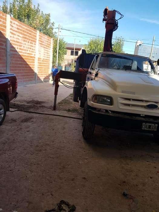 Ford 7000 con hidrogrua Palfinger