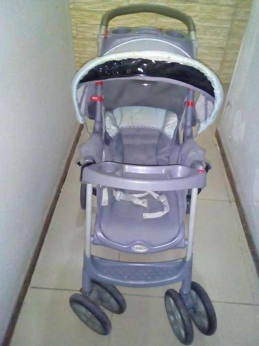 cochecito de <strong>bebe</strong> coche Graco de paseo con una rueda a reparar