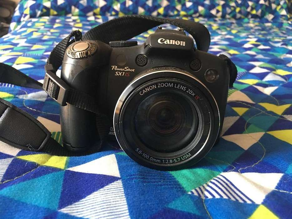 Cámara Canon PowerShot SX1 IS con bolso y pilas recargables