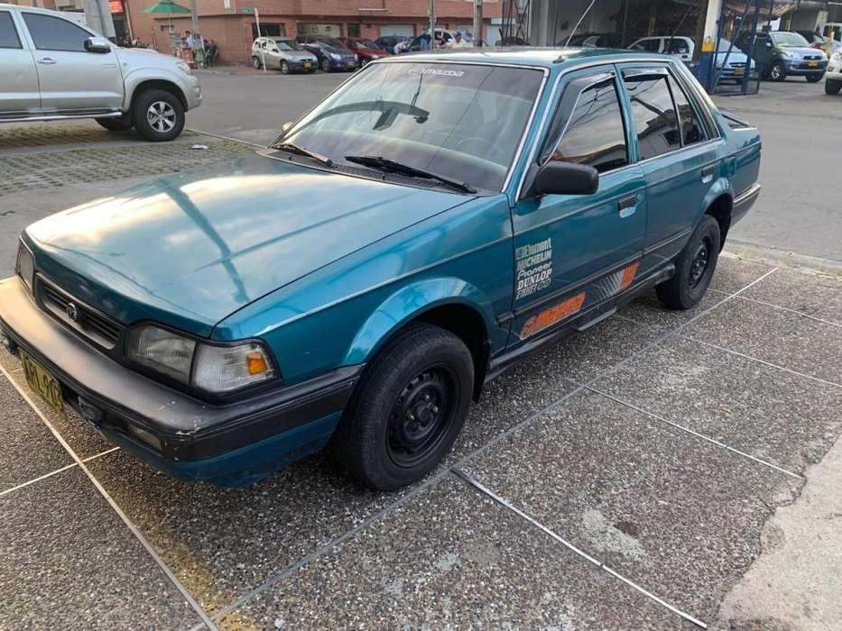 Mazda 323 1992 - 230000 km