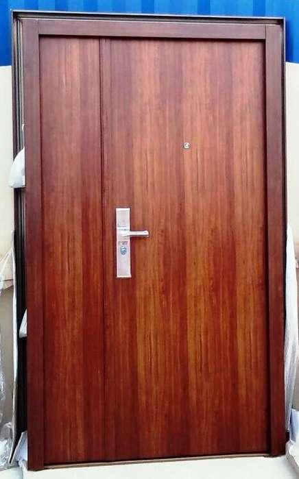 puerta blindada.doble chapa simil madera.de hoja y media ,sistema de cerradura premium
