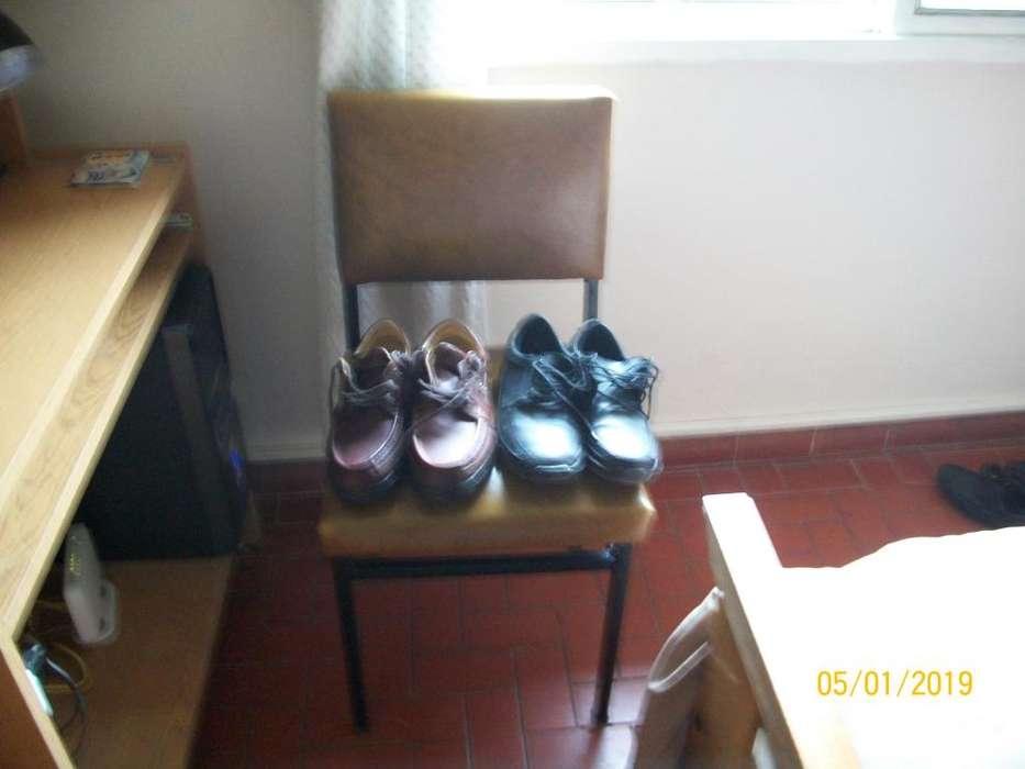 Dos Pares de Zapatos