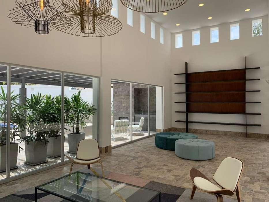 Renta Alquiler Departamento Cumbaya Edificio Kiro, de 3 dormitorios, terraza o sala exterior con chimenea.