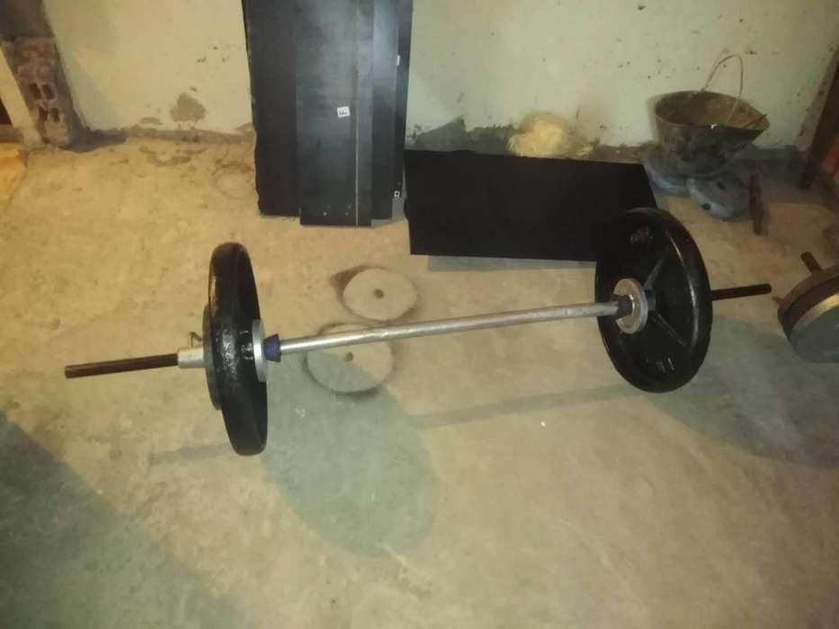 pesas 70 kilos mas barra