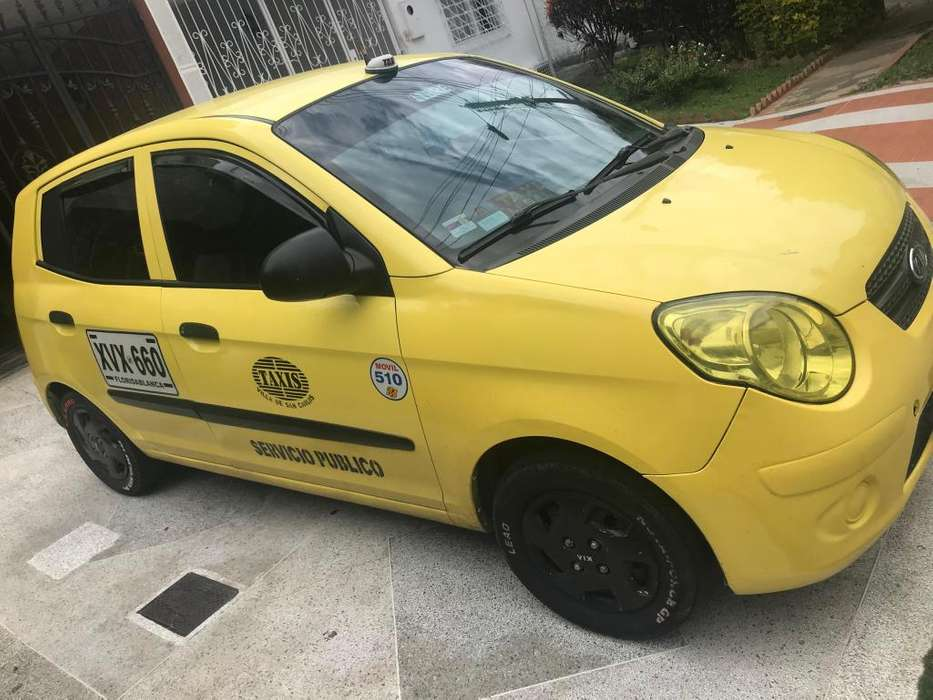 Taxi kia modelo 2009 con cupo metropolitano