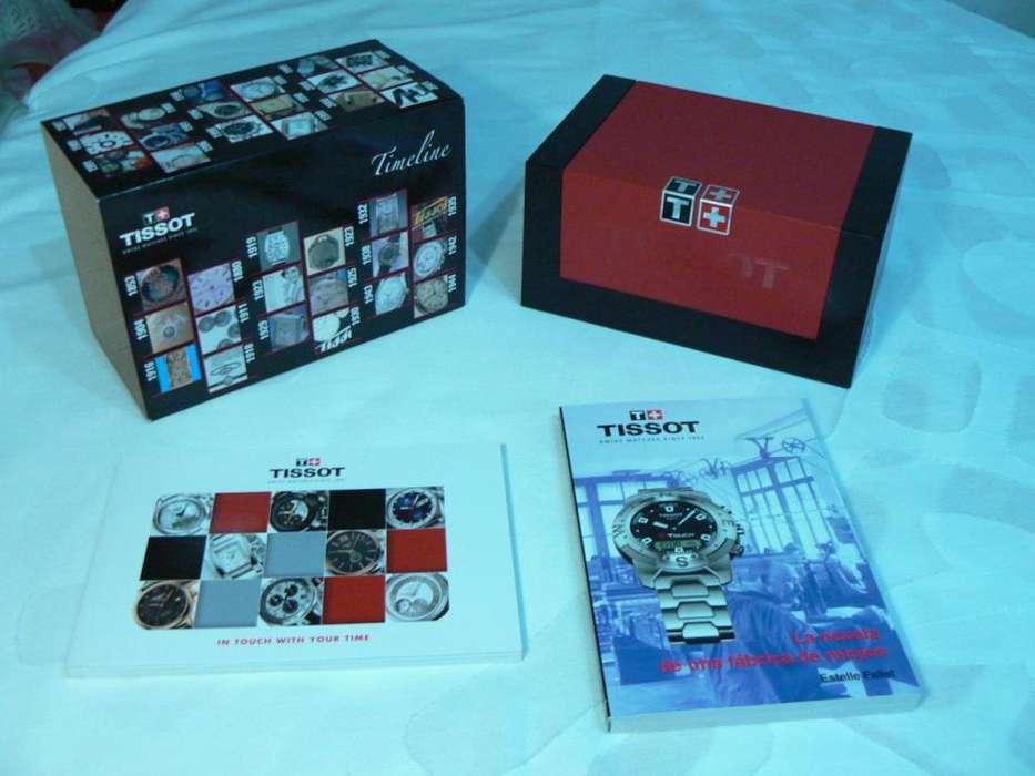 Espectacular Caja con Estuche, Catálogo y Novela de Reloj Tissot
