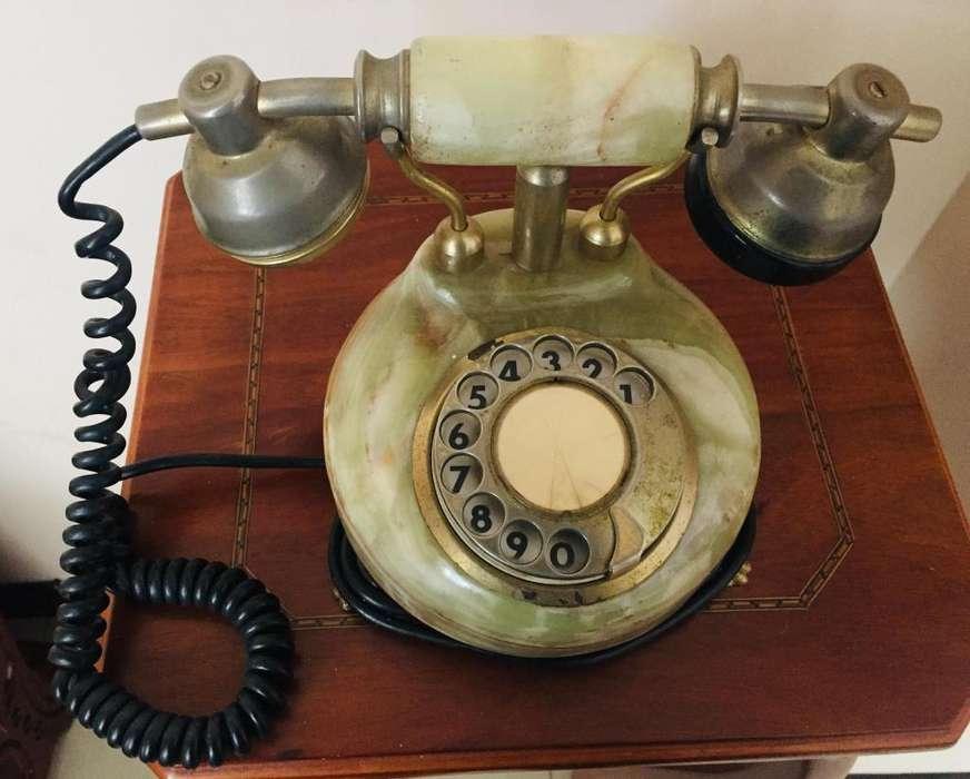Vendo teléfono antiguo por reparar