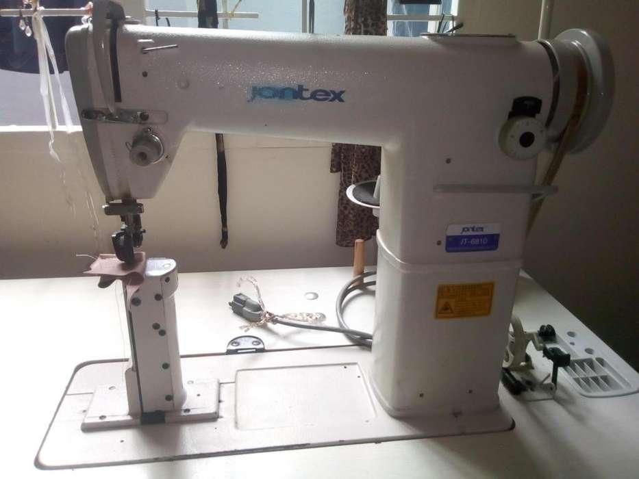 Maquina de coser de poste marca jontex